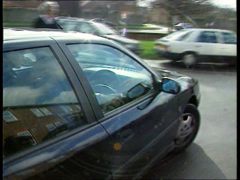 Bucks Bicester Magistrates Court TMS Damon Hill driving car towards as arrives at court PAN LR to BV Hill putting on jacket as along past press PAN...