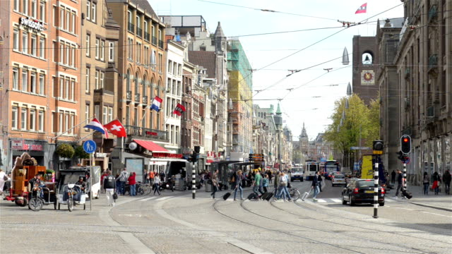 Damrak and central station in Amsterdam from Dam Square