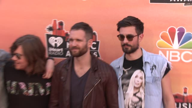 dan smith, chris wood, will farquarson, and kyle simmons of bastille at the 2014 iheartradio music awards - arrivals at the shrine auditorium on may... - バスティーユ点の映像素材/bロール