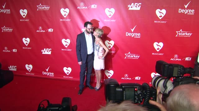 dana brunetti and kristin chenoweth at 2014 musicares person of the year honoring carole king at los angeles convention center on in los angeles... - musicares foundation stock videos & royalty-free footage