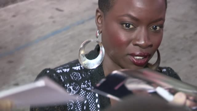 danai gurira greets fans while arriving at the 42 after party in holllywood 04/09/13 - danai gurira stock videos and b-roll footage