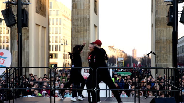 dance activities during the pre-program of the event, dancers can be seen in a close up, the rotes rathaus of berlin in the background. later,... - rathaus stock videos & royalty-free footage