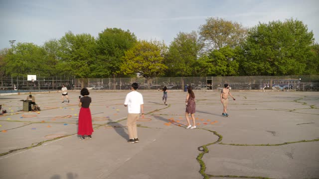 dance circle forms in mccarren park, brooklyn on may 2 in new york city. a few days earlier, mayor bill de blasio said the city aims to fully reopen... - circle stock videos & royalty-free footage
