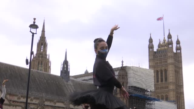 ballet dancers protest in parliament square england london westminster parliament square heard ** various shots of dancers gathered at protest /... - tee stock videos & royalty-free footage