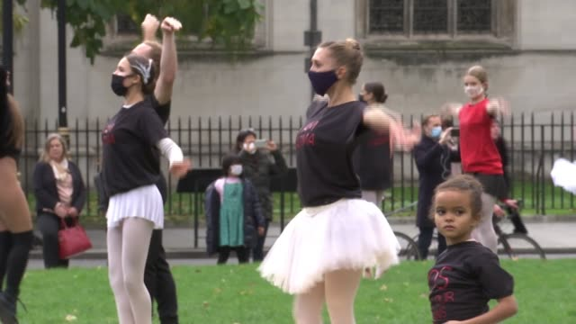ballet dancers stage 'protest' dance in parliament square; ** music heard over following ** england: london: westminster: parliament square: ext... - ballet dancing stock videos & royalty-free footage