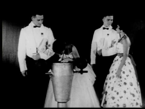 vídeos de stock, filmes e b-roll de 1958 b/w montage dance during june week at annapolis, ring dance ritual where engaged couples exchange rings, annapolis, maryland, usa, audio - aliança de casamento