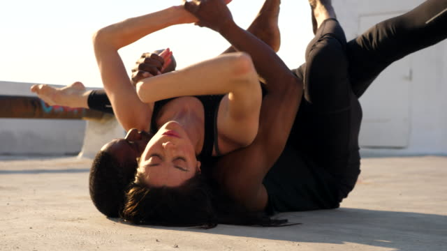 ms dance partners embracing each other while performing on rooftop - tights stock videos & royalty-free footage