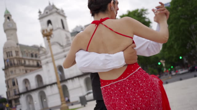 dance partners performing tango argentino outdoors - tangoing stock videos & royalty-free footage