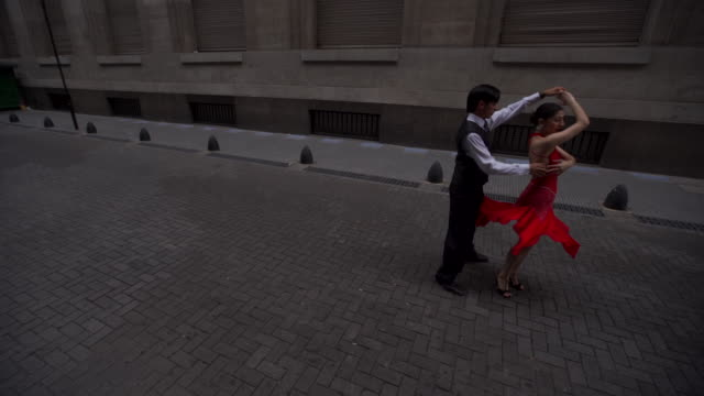 dance partners performing tango outdoors - tangoing stock videos & royalty-free footage