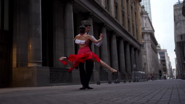 dance partners performing tango outdoors - tango dance stock videos & royalty-free footage