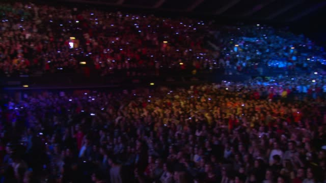 dance troupe and crowd at we day uk at wembley arena on march 7, 2014 in london, england. - wembley arena stock videos & royalty-free footage