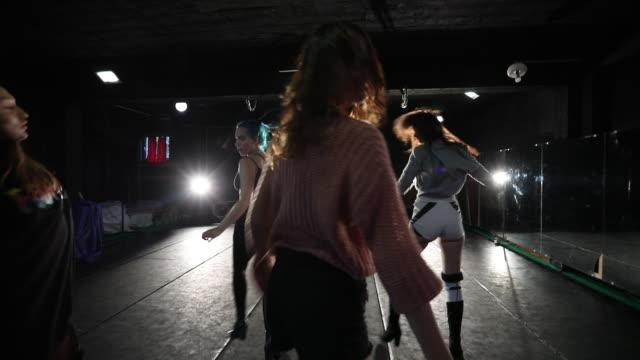 dance troupe dancing on dance floor - modern dancing stock videos & royalty-free footage