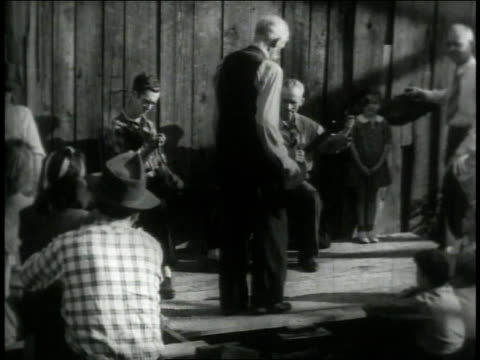 1946 ws dancer clogging as band plays behind him / united states - banjo stock videos & royalty-free footage