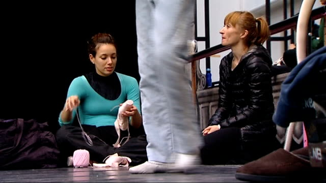 dancer holding ice pack to her foot dancer tying ribbons of ballet shoes dancer lacing shoes costume makers sewing costumes at table close shot hand... - the nutcracker named work stock videos & royalty-free footage