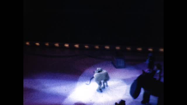 dancer in pinocchio suit dancing and spinning on ice under the spotlight; dancers pluto suit dancing and spinning on ice under the spotlight, rolling... - pinocchio stock videos & royalty-free footage