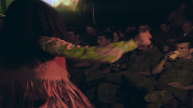 zo dancer on club stage dancing for audience of soldiers / da nang vietnam - ダナン点の映像素材/bロール