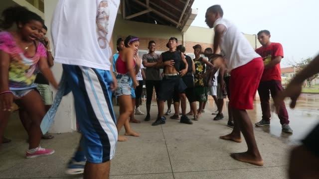 vídeos de stock, filmes e b-roll de dancer performs during a 'passinho' battle at the manguinhos community, or 'favela', on december 13, 2014 in rio de janeiro, brazil. passinho means... - funky