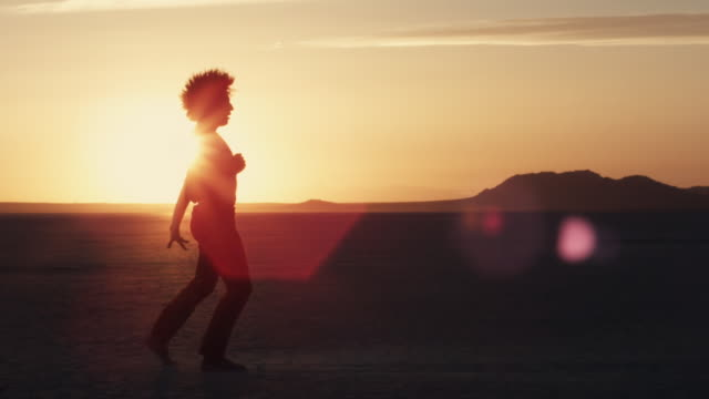 A dancer performs on the dry lake bed of El Mirage, California.