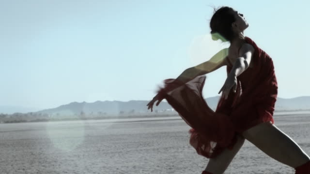 a dancer performs on the dry lake bed of el mirage, california. - modern dancing stock videos and b-roll footage