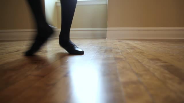 WS Dancer practicing his ballet steps in dance studio / Chicago, Illinois, USA