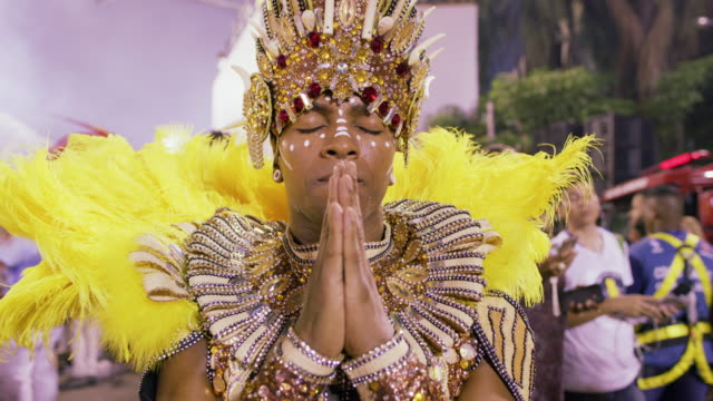 CU A dancer prays before the start of Rio Carnival parade / Rio de Janeiro, Brazil