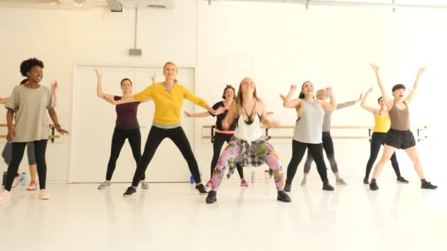 dancer teaching female students in dance studio - arms raised stock videos & royalty-free footage