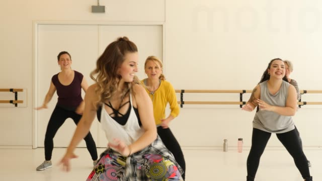 dancer teaching female students in fitness class - hip stock videos & royalty-free footage