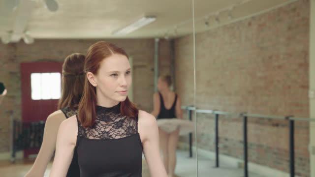 dancer watches other dancer - elastane video stock e b–roll