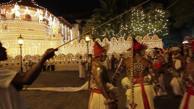 ms pan dancers and elephants prepare for buddhist procession 'esala perahera' in front of 'temple of tooth' audio / kandy, central province, sri lanka - sri lankan culture stock videos and b-roll footage