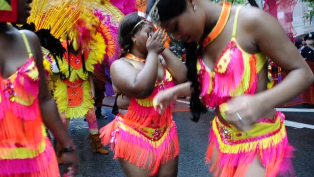 vídeos de stock e filmes b-roll de dancers at the labor day parade eastern parkway crown heights brooklyn new york city usa also known as the west indian american day carnival dancers... - 2013