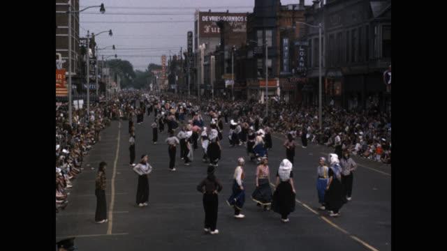 stockvideo's en b-roll-footage met dancers dancing on street during tulip festival, holland, michigan, usa - minder dan 10 seconden