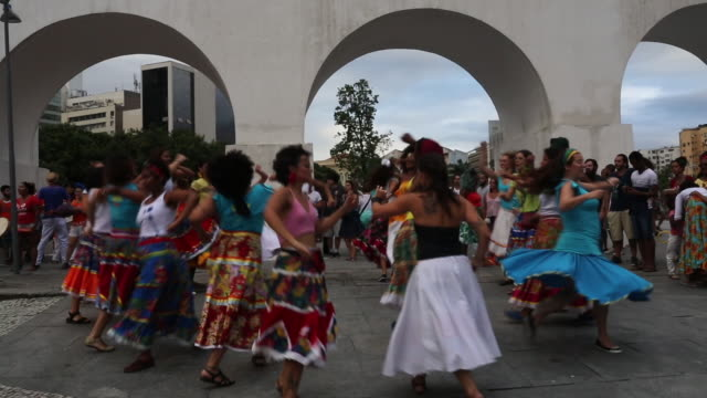 dancers from the traditional brazilian folkloric performance group rio maracatu perform beneath the famed lapa arches during their first precarnival... - brazilian carnival stock videos and b-roll footage