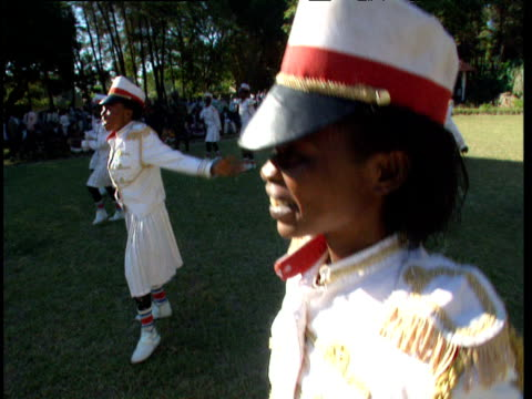 dancers in military uniform perform during political rally democratic republic of congo - military uniform stock videos & royalty-free footage