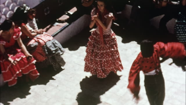 vidéos et rushes de dancers in native costumes perform the flamenco. - spain
