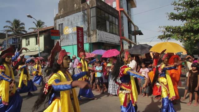 MS PAN Dancers in traditional costumes parade in Buddhist Perahera Festival in Hikkaduwa AUDIO / Hikkaduwa, Southern Province, Sri Lanka