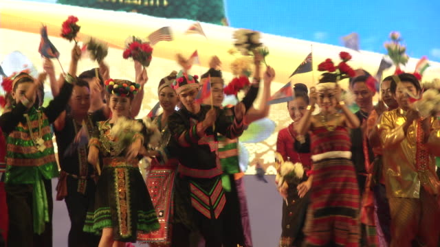 dancers in traditional laos clothing perform at a welcome dinner during the association of southeast asian nations summit the laotian capital... - association of southeast asian nations stock videos & royalty-free footage