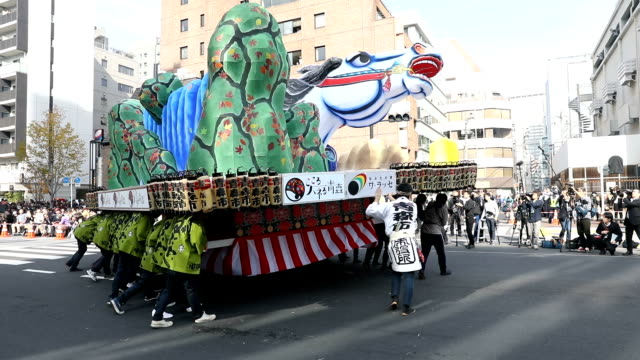 Dancers musicians float bearers and other participants in six famed festivals from the Tohoku region put on a unified parade down Shintoradori avenue...