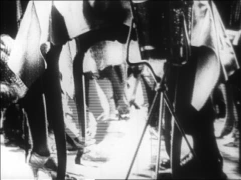 b/w 1928 montage dancers, musicians + musical instruments in nightclub act / newsreel - jazz stock videos & royalty-free footage
