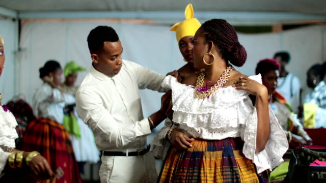 Dancers of a Caribbean dance ensemble behind the stage