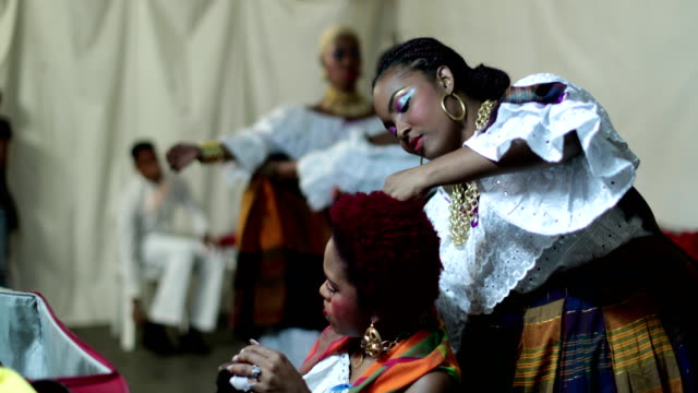 dancers of a caribbean dance ensemble behind the stage - hoop earring stock videos and b-roll footage