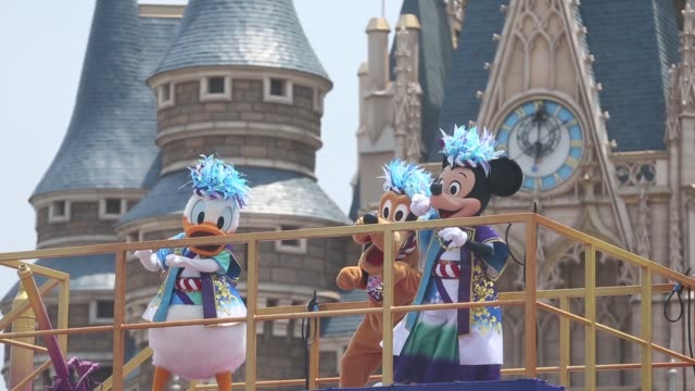 dancers perform in front of the cinderella castle during the disney natsu matsuri event at tokyo disneyland operated by oriental land co in urayasu... - disney stock videos and b-roll footage