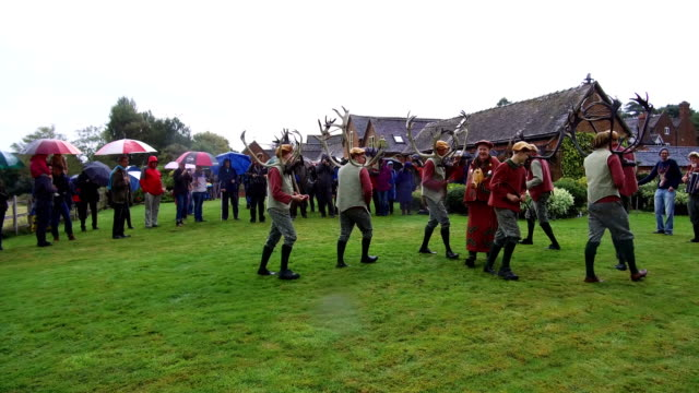 dancers perform the abbots bromley horn dance outside blithfield hall on september 11 2017 in abbots bromley united kingdom the dance comprising of... - 枝角点の映像素材/bロール