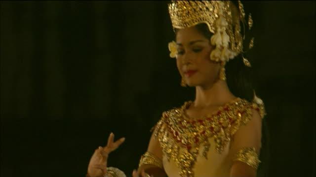 Dancers performing recreation of Apsaras at Angkor Wat at night Cambodia