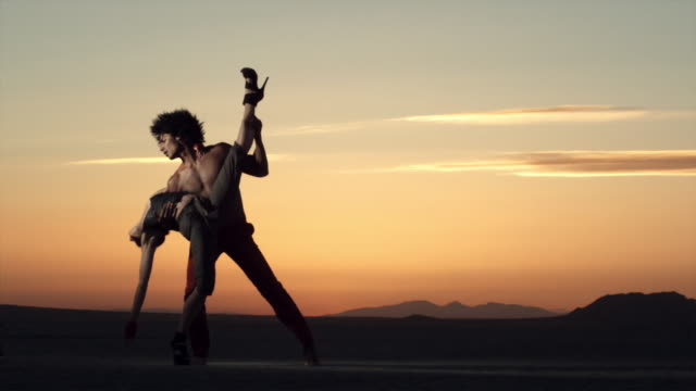 dancers performs on the dry lake bed of el mirage, california. - modern dancing stock videos & royalty-free footage
