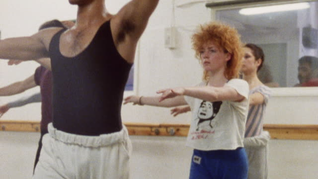 vídeos de stock e filmes b-roll de 1985 montage dancers practicing a dance routine and exercising / london, england† - 1985