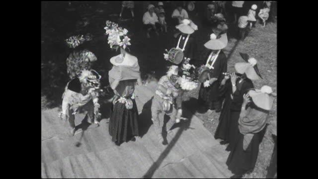 vidéos et rushes de dancers rehearse a japanese-lion costume dance on a stage. - après guerre