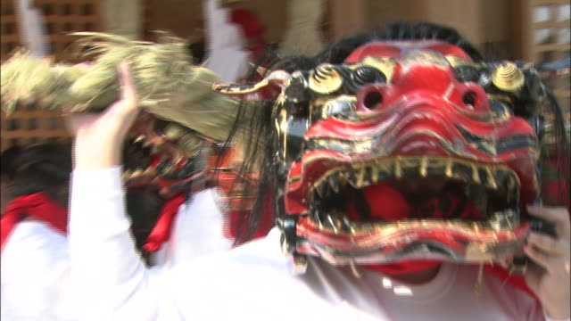 dancers wear ogre masks as they perform at the gatchi festival in japan. - shimane prefecture stock videos & royalty-free footage