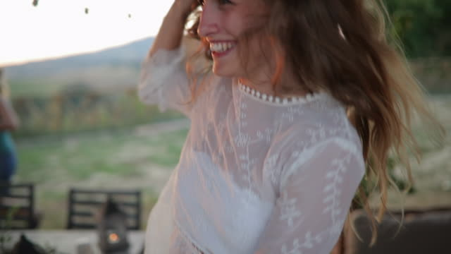dancing and laughing at sunset - sundress stock videos & royalty-free footage