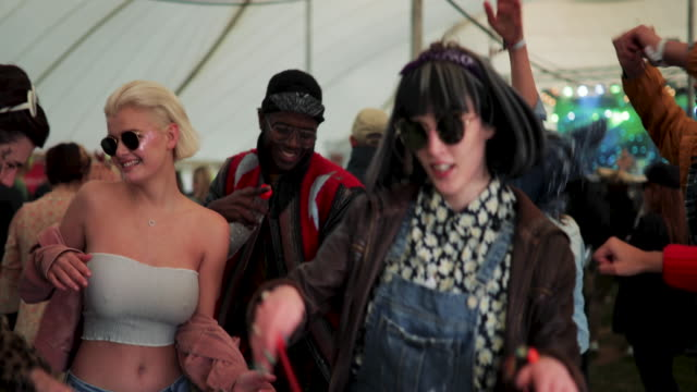 dancing at a festival - millennial generation stock videos & royalty-free footage
