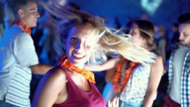Dancing at a nightclub.